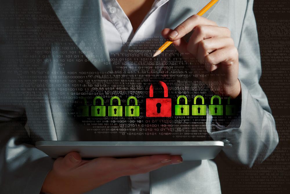 Businesswoman holding tablet pc entering password. Security concept